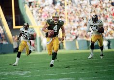 Green Bay Packers quarterback Brett Favre (4) runs for a first down while being chased by Pittsburgh Steelers linebacker Greg Lloyd (95) in the third quarter of their game in Green Bay on Sept. 27, 1992. The Packers went on to win the game 17-3.