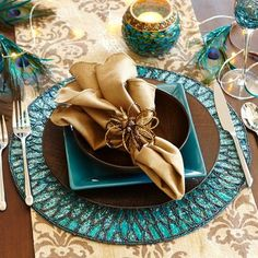 Well, you always said you wanted to make a splash with your dinner parties. Our ocean-tinted placemat adds color, of course, but also the amazing shimmer of hundreds of intricately sewn glass beads. Dining Room Table Decor, Decoration Table, Dining Room Design, Kitchen Decor, Peacock Dining Room, Decoration Crafts, Kitchen Dining, Décoration Table Nouvel An, Deco Table Noel