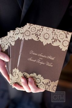 Look through this wedding...a lot of cute ideas with a hint of the outdoors (like the log holding the placecards).  Bright color accent with the taupe and brown hints.  Also love the menu card.