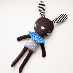 Black white and gray bunny for children. Handmade stuffed toy