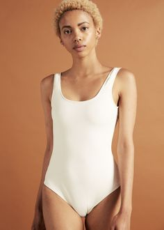 A scooped neckline and low cut back one piece swimsuit. Swimsuits, Swimwear, One Piece Swimsuit, Retail, Neckline, Swimming, African, Clothes For Women, Easy