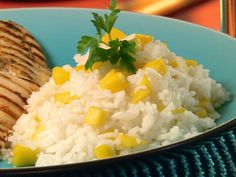 Mango Coconut Rice from FoodNetwork.com  This slightly sweet side dish would go well with chicken, pork, or fish.  (I used coconut oil instead of olive oil and added some flaked coconut with the rice.)