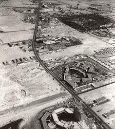 Aerial view of Las Vegas Strip, Early Sands hotel tower can be seen under construction in the upper middle part of the photo. Lower left, the beginnings of Caesars Palace. Old Vegas, Vegas Fun, Vegas Casino, Las Vegas Strip, Las Vegas Nevada, Mega Series, Atlantic City Casino, Cities, Sands Hotel