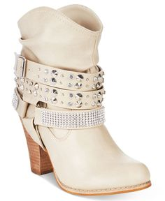 Dolce by Mojo Moxy mixes edgy glam with Western styling on these Bundles booties…