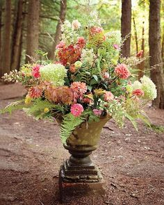 An antique urn greeted guests with hydrangeas, zinnias, and dahlias grown by friends and family.