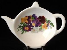 This is a Royal Patrician, England teapot shaped bone china tea bag holder or teabag caddy. The little teapot shaped dish is .75 inch high by 4.5 inches long by 3.25 inches wide with a pattern of mult