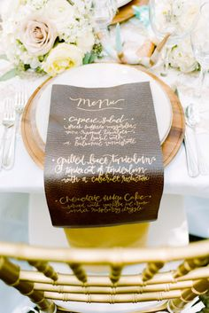 Place setting with menu in #gold script on faux leather. Photo Source: 100 layer cake #tablesetting #menucard