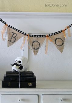 How to make a burlap bunting, you'll love how quick this Halloween banner is! Fast home decor idea using burlap and ribbon. Best part? No sew!