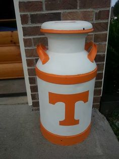 Tennessee Vols milk can.. I have a milk can I can paint it orange & white..