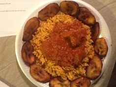 My very own jollof rice w/ goat meat stew and plantain! Yummerz