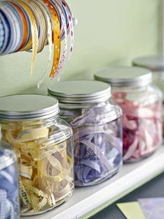 Handy Ribbon Storage  Use ribbon as a decorative accent. Placing scraps of ribbon in glass canisters is a great way to keep scraps tidy and add color to your space. For your favorite rolls, hang a small rod and place ribbon across, sorting by color or pattern.