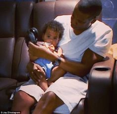 Want to listen to Daddy's latest album... no? Blue Ivy looks unimpressed as her father Jay tries to get her to listen to some music on tour