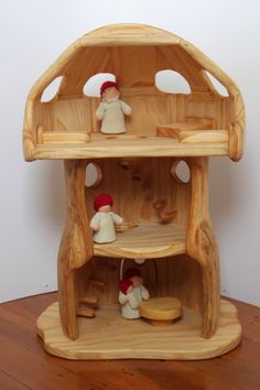 Wooden Mushroom House, I like how it has some furniture built in to it. Less things to mess with!