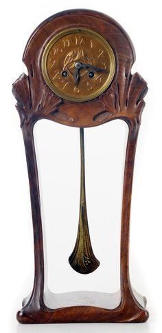 "MAURICE DUFRENE clock, c. 1900, for ""La Maison Moderne"", Paris, mahogany, gilt brass, 45 cm h."