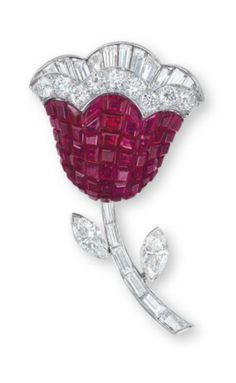 """A """"MYSTERY SET"""" RUBY AND DIAMOND BROOCH, BY VAN CLEEF & ARPELS  Designed as a calibré-cut ruby flower with brilliant, tapered baguette and baguette-cut diamond trim, joined to the baguette and whistle-cut diamond stem and marquise-cut diamond leaves, mounted in platinum, 1958, 4.7 cm long, in blue suede Van Cleef & Arpels case"""