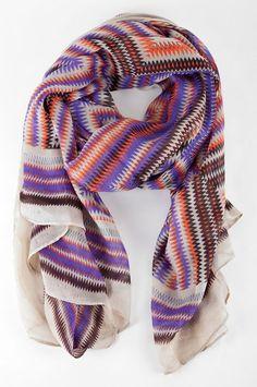 Tangerine and purple scarf.