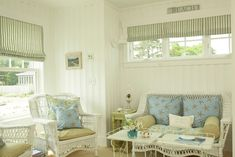 Perfect idea for mobile home addition....white wainscotting with wicker furniture from craigslist