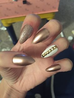 "Stiletto nails by me. Rose gold Essie ""penny talk"" Rose gold glitter and Barry M white"