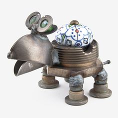 Handcrafted in Kentucky, this darling CK Nuts the Turtle is made using scrap and reject metal, and features a cabinet knob as the body. The cabinet knob may vary. Quintessentially cute, these critters