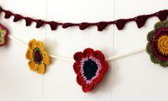 Crochet flowers make fabulous garland. Flower Garlands - Media - Crochet Me