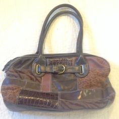 Brown patchwork purse Lovely combination of browns in patchwork. Excellent condition.  Bundle deals available in my closet, which carries various brands & sizes. 10% off 2, 15% off 3 and 20% off 4 or more. Bags