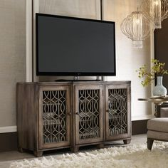 """Features:  -Materials: Hardwood solids and walnut veneers.  -2 adjustable shelves behind each door.  -1 Three plug outlet.  TV Size Accommodated: -64"""".  Product Type: -TV Stand.  Design: -Enclosed sto"""