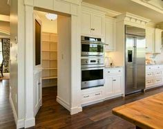 Walk in pantry behind the kitchen