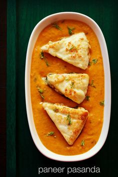 restaurant style paneer pasanda recipe. a rich recipe of shallow fried stuffed paneer in a smooth, creamy onion-tomato based gravy.