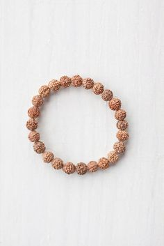 Om Mala Beads Bracelet | $10.50 Rudraksha seeds are believed to help quiet the mind and free negative thought as well as increase clarity and general awareness. #malabeads #rudraksha #meditation