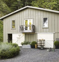 plain, made to look fancier with barn doors. Like the pebbled ground