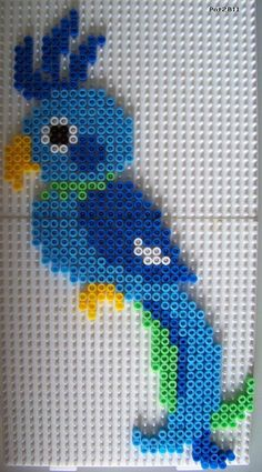 pearls and repasser: animaux - Les loisirs de Pat - Vogel Bügelperlen Bird hama pearls beads.Without tail and with dark blue stripes on the stomach th - Perler Bead Designs, Hama Beads Design, Diy Perler Beads, Perler Bead Art, Pearler Beads, Pearler Bead Patterns, Perler Patterns, Hama Beads Animals, Motifs Perler