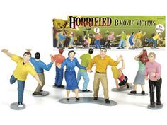 "In our Horrified B-Movie Victims playset, we provide the victims, you provide the terror! Each dramatic Horror Movie Victims play set includes nine 2-1/2"" to 3"" tall, hard vinyl victims captured in utterly terrified poses!    Are they reacting to the advances of a giant, man-eating tomato or the sight of your grandma in her nightgown and curlers?    The possibilities are endless!    Add the classic Horrified B-Movie Victims playset to your desk toy collection while it's still in stock."