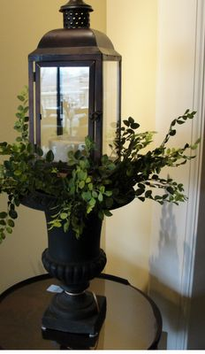 Using urns & lanterns....would look great inside or on a front porch