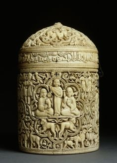 Pyxis of al-Mughira    Author : Madinat al-Zahra?, Spain  Date / period : AH 357/AD 968  Materials and techniques : Carved ivory with traces of jet  Conservation place : Musée du Louvre, Islamic Art Department