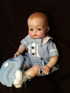 18 in Effanbee baby doll of compo & cloth with flirty eyes