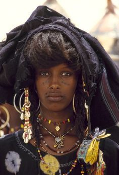 A WODAABE Woman from The WODAABE People (sometimes called BORORO) are part of The FULANI 'Family'. They are Traditionally Nomadic Cattle Herders and Traders in the SAHEL travelling from SOUTHERN NIGER through NORTHERN NIGERIA, NORTH-EASTERN CAMEROON, SOUTH-WESTERN CHAD, and the WESTERN region of the CENTRAL AFRICAN REPUBLIC. <