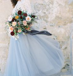 Forgo the traditional white wedding dress and add a little color to your day. The beautiful lace top coupled with a blue ballerina skirt will make you feel every bit a princess on a day that is all about you (and your partner, of course!). | A Wonderful Winter Wedding Dress for Your Big Day