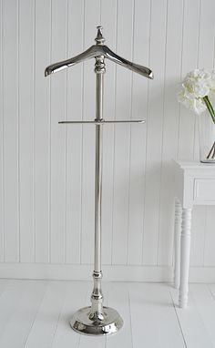 A beautiful chrome metal valet stand for jackets and trousers from The White Lighthouse