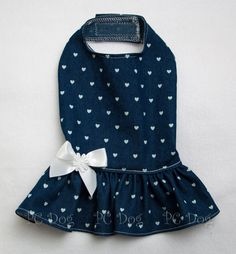 - Great dress that will match almost any shirt - Dark Denim with small white hearts - White bow with daisy center at waist - It easily attaches with adjustable velcro neck and belly straps - Open ches