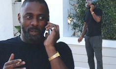 Idris Elba lights up a cigarette outside LA hotel following SAG wins