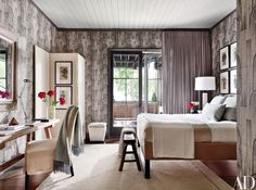 Another guest room features a Groundworks wallpaper from Lee Jofa and a custom-made bed.