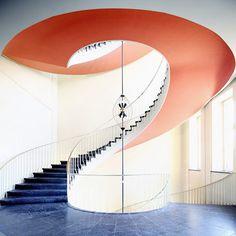 Orange & Blue spiralling staircase.....impressive