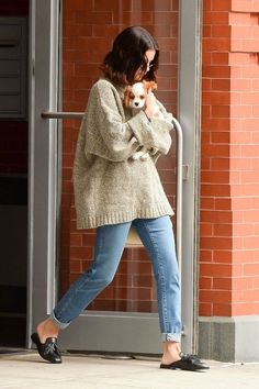 5be916f42d0 Selena Gomez In a chunky sweater with rolled-up jeans, leather slip-on