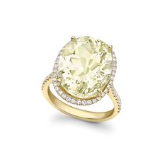 A stunning oval lemon quartz stone surrounded by dazzling diamonds in 18ct yellow gold.- the perfect ring to add a touch of glamour to any outfit.