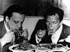 Frank Sinatra and Frank Palumbo eating a spaghetti dinner together.