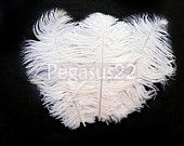 WHITE Ostrich Feather Drab cruelty free craft item for hats, hair fascinators and wedding centerpieces. 6 - 8 inches long (3 Feathers). $6.00, via Etsy.