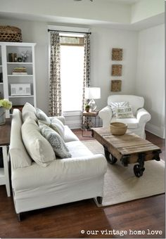 coffee table; slip covered furniture.