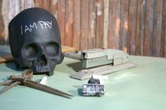 Chalkboard Skulls by iamhome - could paint dollar store skulls