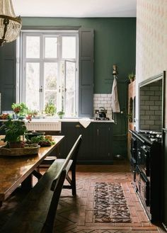 If you admire dark green paint colors and are seeking inspiration from interiors, you're about to feel woozy with deilght!