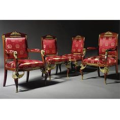 A SET OF FOUR EMPIRE STYLE GILT-BRONZE MOUNTED MAHOGANY CHAIRS FRENCH, CIRCA 1890 comprising two armchairs and two chairs, each with pediment padded seat, upholstered with red and gold silk, the padded armrest headed with eagle head, on griffin monopodiae front supports.
